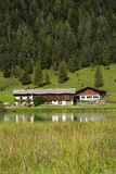 Lake Pillersee with farmhouse in Sankt Ulrich am Pillersee, Austria Royalty Free Stock Images