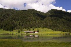 Lake Pillersee with farmhouse in Sankt Ulrich am Pillersee, Austria Royalty Free Stock Image