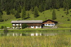 Lake Pillersee with farmhouse in Sankt Ulrich am Pillersee, Austria Stock Image