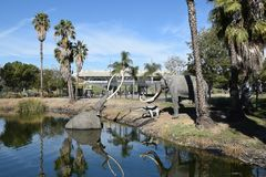 Lake Pit at the La Brea Tar Pits. LOS ANGELES - NOVEMBER 24, 2017: Lake Pit at the La Brea Tar Pits.  Pleistocene mammoth statues depict how animals became Stock Photo