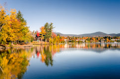 Lake Placid at the Foliage Peak and Reflection in Water Stock Photo