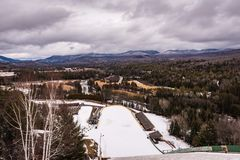 Ski Jump Tower View. Lake Placid, New York / USA/ Feb. 21, 2016: Visitors can ride elevator to top of ski jump towers at the Lake Placid Olympic Ski Jumping Royalty Free Stock Photography