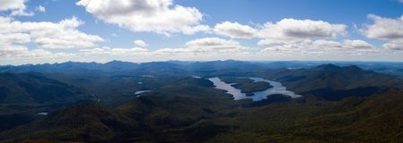 Lake Placid panoramic. Panoramic view of Lake Placid viewed from Whiteface mountain, Adirondack mountains, New York state, U.S.A Stock Photos