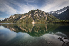 Lake Plansee in Austria with panorama of the Alps Royalty Free Stock Photos
