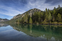 Lake Plansee in Austria with panorama of the Alps Royalty Free Stock Image