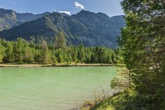 Lake Plansee with mountaind in the background stock photography