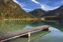 Lake Plansee with pier in Austria during autumn Stock Image