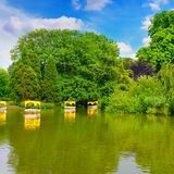 Lake and pleasure boats. Picturesque lake and pleasure boats Stock Images