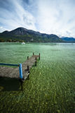 Lake pontoon. Wide angle view of a pontoon on a lake with mountains in the horizon, lake Annecy, France Stock Image