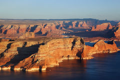 Lake Powell lit up rays of the sunset Royalty Free Stock Photography