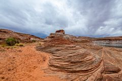 The Lake Powell National Recreation Area. Storm clouds pass over the Lake Powell National Recreation Area creating an ominous landscape scene royalty free stock image