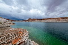 The Lake Powell National Recreation Area. Storm clouds pass over the Lake Powell National Recreation Area creating an ominous landscape scene stock photography
