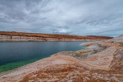 The Lake Powell National Recreation Area. Storm clouds pass over the Lake Powell National Recreation Area creating an ominous landscape scene royalty free stock images