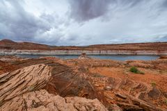 The Lake Powell National Recreation Area. Storm clouds pass over the Lake Powell National Recreation Area creating an ominous landscape scene royalty free stock photos