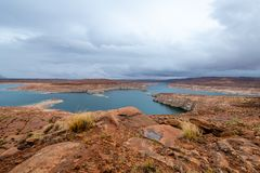 The Lake Powell National Recreation Area. Storm clouds pass over the Lake Powell National Recreation Area creating an ominous landscape scene stock photos
