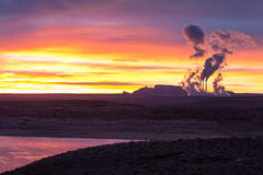 Lake Powell at sunrise, clouds and Navajo power station Royalty Free Stock Photos