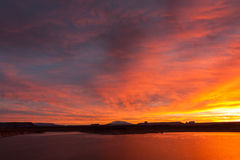 Lake Powell at sunrise, clouds and sunlight Royalty Free Stock Photography