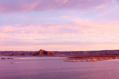 Lake Powell at sunrise, clouds and sunlight. Lake Powell at sunrise, mountains and rocks, clouds and sunlight Stock Images