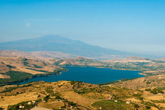 The lake of Pozzillo, with volcano Etna in background. Aerial view of the lake of Pozzillo (inner Sicily), with volcano Etna in background; the town in the right Stock Photography
