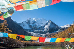Lake with prayer flag Royalty Free Stock Photo