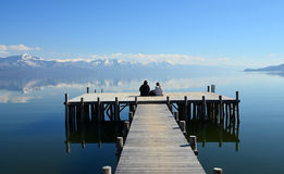Romance on a pier on Lake Prespa, Macedonia Stock Photos
