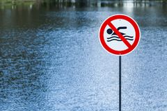 Lake with prohibited sign swimming Royalty Free Stock Photography