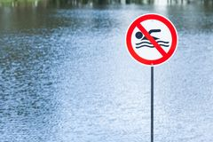 Lake with prohibited sign swimming Royalty Free Stock Image
