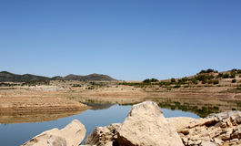 Lake in the Province of Malaga, Andalusia, Spain. Lake and rocks in the Province of Malaga, Andalusia, Spain Stock Photos