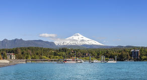 Lake in Pucon and snow covered Volcano Villarica. Royalty Free Stock Photo