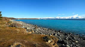 Lake Pukaki with bright blue, turquoise water in winter. Lake Pukaki with bright blue, turquoise water and snow mountains on the background. Sunny day winter stock video footage
