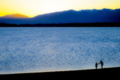 Lake pukaki in the evening. Silhouette of two sister at lake pukaki in the evening Stock Image