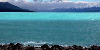 Lake Pukaki.Glacier blue waters Stock Photos
