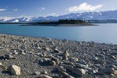 Lake Pukaki, glacier water, low lake level, New Zealand. Island on Lake Pukaki, glacier water, low lake level, New Zealand royalty free stock photography