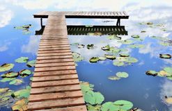Lake, quay and water lilies Royalty Free Stock Image