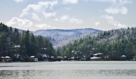 Lake Rabun in Winter. Beautiful Lake Rabun after a winter snow.  Ice on the distant mountains and some snow still on the banks of the lake Stock Images