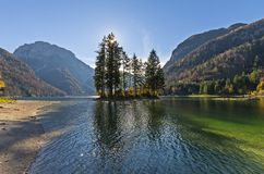 Lake of Raibl. An image of the lake of Raibl also called lake of Cave del Predil on the Alps of Friuli Italy taken during an afternoon in autumn with backlight Stock Photo