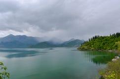Lake at the rain. Skadar Lake in the rain at spring in Montenegro Royalty Free Stock Photos