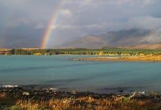 Lake and rainbow Stock Photo