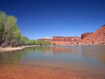 Lake with red stones in Canyonlands Royalty Free Stock Images