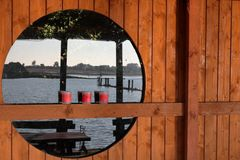 Lake reflected in round window royalty free stock photo