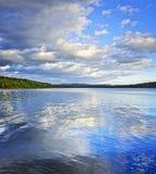Lake reflecting sky stock images