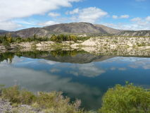 Lake reflecting the sky. And the mountains in Tucuman, Argentina royalty free stock images