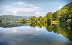 Lake reflection. Beautiful lake view with clear reflection Royalty Free Stock Images