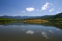 Lake reflection. Beautiful lake landscape reflection on calm water Royalty Free Stock Image