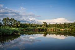 Lake reflection. Beautiful lake view - bright interval between rain Royalty Free Stock Photography