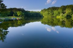 Lake Reflection. Beautiful Reflection of the blue sky in a calm water stock photography