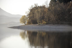 Lake reflection with autumn trees and clear sky Stock Photo
