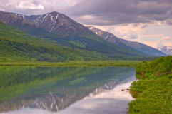Lake Reflection in Chugach National Forest. A reflection of a snow-capped mountain in a lake in Chugach National Forest on Kenai Peninsula, Alaska stock image