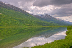 Lake Reflection in Chugach National Forest. A reflection of a snow-capped mountain in a lake in Chugach National Forest on Kenai Peninsula, Alaska royalty free stock photo