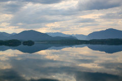 Lake with a reflection of the clouds stock images